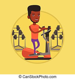 Man exercising on elliptical trainer. - African man...