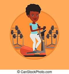 Woman exercising on elliptical trainer. Woman working out...