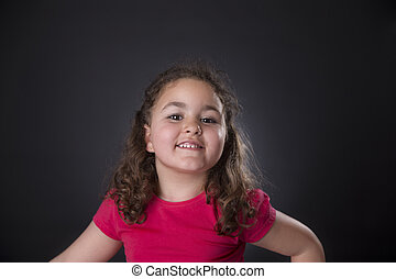 Four years girl laughing - Portrait of a brunette and curly...