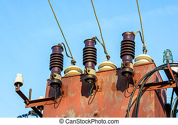 Electric transformer on blue sky background