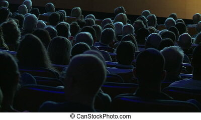 Moviegoers from their back - Shot of Moviegoers from their...