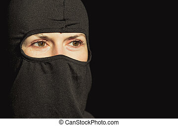 Girl offender. The girl in a black mask.