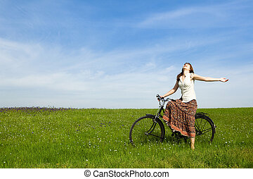 Girl with a bicycle - Happy young woman with a vintage...