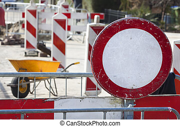 Road work and a no entrance sign