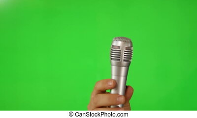 Microphone over green screen - Shot of Microphone over green...