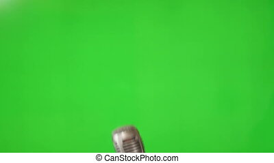 Microphone on green screen - Shot of Microphone on green...