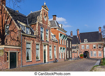 Street with old houses in the historical center of Groningen