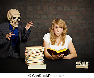 Woman reads a scary books - A woman reads a scary books in...