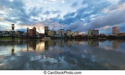 Dramatic clouds moving over downtown Portland Or with water reflection at sunset