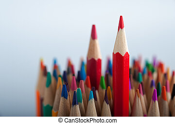 Bright colorful pencils background with copyspace. Red...