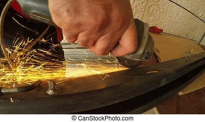 Metal grinder produce sparks - Shot of Metal grinder produce...