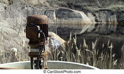 Industrial Mining Abandonded Sump Pump Pull Focus - Pulling...