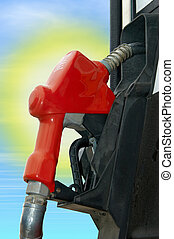 Gas pump with sun in the background