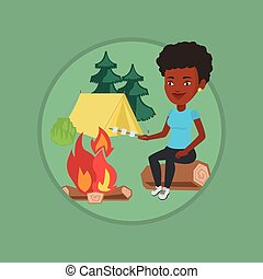 Woman roasting marshmallow over campfire. - African woman...