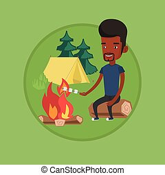 Businessman roasting marshmallow over campfire. - Young...