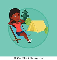 Woman sitting in folding chair in the camp. - African woman...