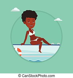 Young happy woman tanning on sailboat. - African-american...