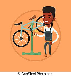 African bicycle mechanic working in repair shop. -...