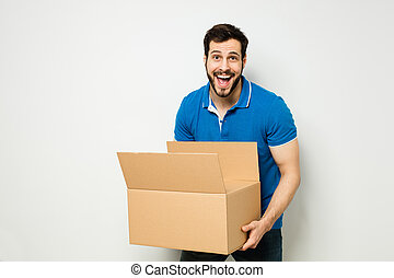 young man with a cardboard box in his arms - enthusiastic...