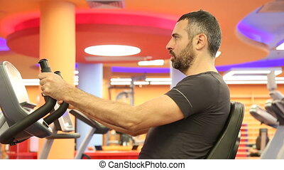 Man spinning in the gym - Shot of Man spinning in the gym