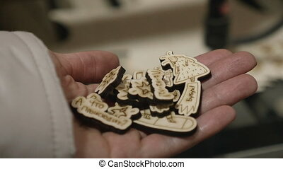 Result of work of laser engraving and cutting on wood.