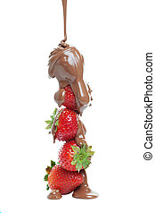 Chocolate strawberries - Milk chocolate being poured over a...