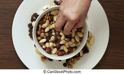 Couple Eating Mixed Nut Trail Mix Overhead Closeup - A...