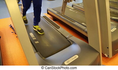 Man on a treadmill inside the gym - Shot of Man on a...