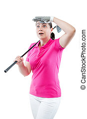 Surprised woman golfer looking where the ball flew away on a...