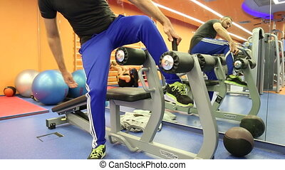 Man doing sit ups in the gym - Shot of Man doing sit ups in...