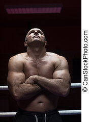 kickboxer with arms crossed - portrait of muscular...