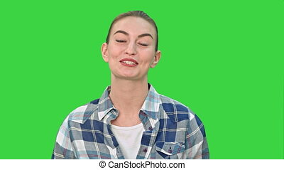 Cheerful young woman talking to a camera on a Green Screen, Chroma Key.