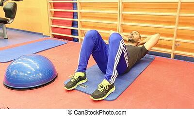 Man abs workout - Shot of Man abs workout