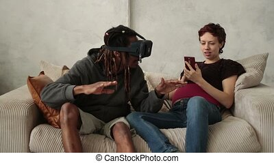 Multiethnic couple using new trends technology - Mixed...