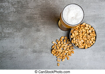 Glass of beer and peanuts - Glass of beer and snack of...