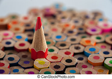 Red pencil among colorful crayons - One sharpened red pencil...