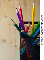 Colorful pencils on wooden table. Painting, sketching and...
