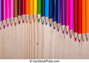 Wooden crayons background with copyspace - Multicolored...