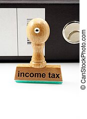 income tax concept with stamp in office showing bureaucracy