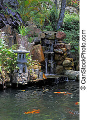 Koi fish ponds and water fountain - According to Chinese...
