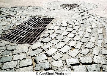 Steel sewer manhole on road - Steel sewer manhole on old...
