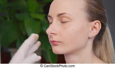 Cosmetic treatment with botox injection in a clinic
