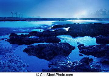 Moon light on the rock seacoast