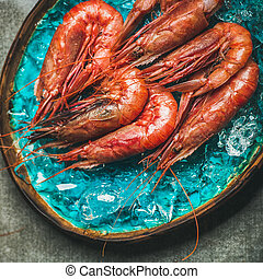 Raw uncooked red shrimps on chipped ice, square crop - Raw...