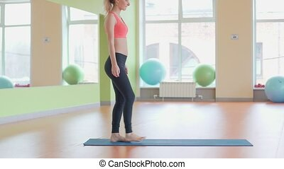 Beautiful athlete woman exercising in fitness club. -...