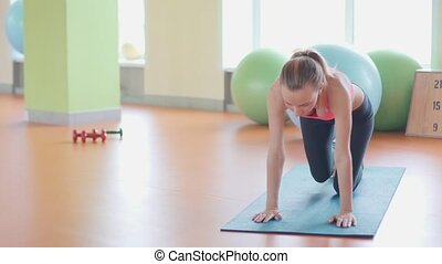 Girl doing warming up exercise for spine, backbend, arching...