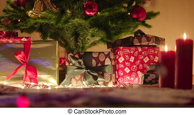 Panorama view of gifts under the decorated christmas tree -...