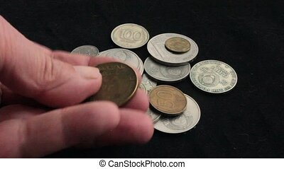 collection of coins through a magnifying glass - to see the...