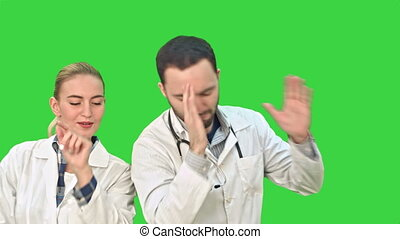 Medical collegues celebrating, dancing and singing on a Green Screen, Chroma Key.