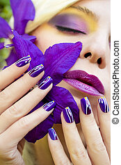 Summer purple yellow makeup and manicure .